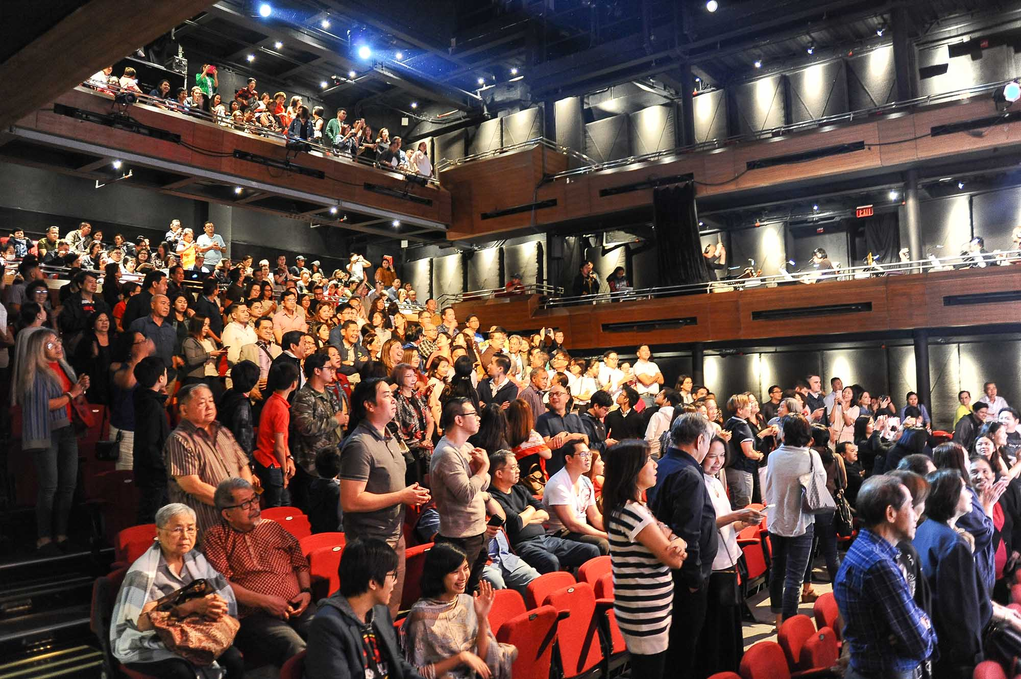 In Photo 4 Alumni and guests as they give the cast a standing ovation