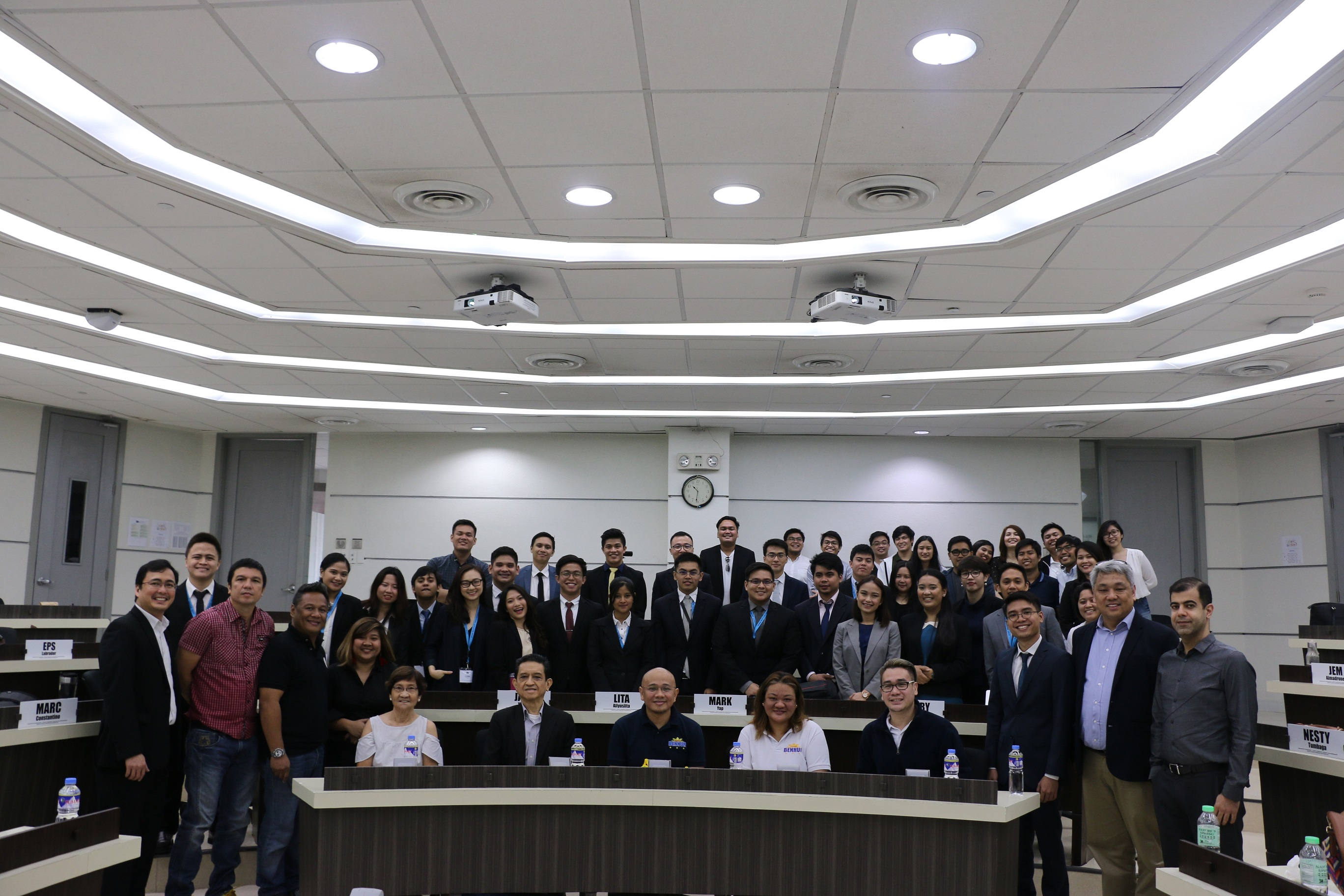 Professor Matthew Escobido (leftmost) with the students and professors of the Master of Science in Innovation and Business program and officials of Barangay Poblacion.